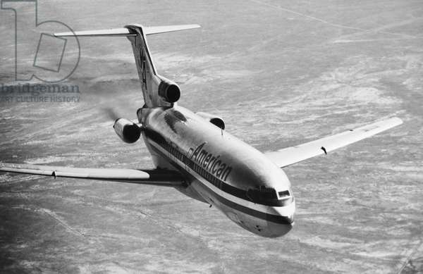 BOEING 727 AIRPLANE A Boeing 727 airplane operated by American Airlines, in flight. Photograph, late 20th century.