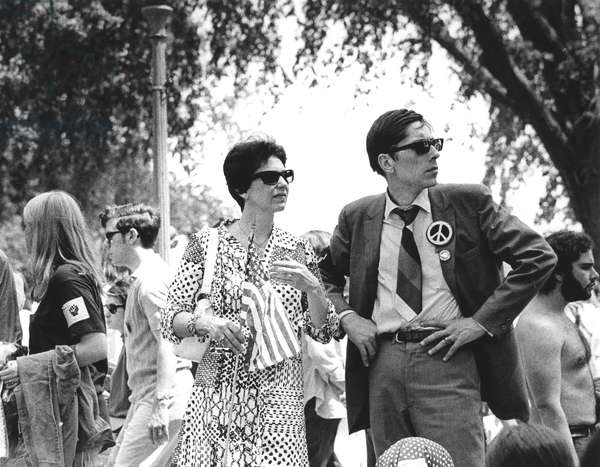 ANTI-WAR PROTEST, 1970 A young middle-class couple join thousands in Washington, D.C., on 9 May 1970, to demonstrate against the Vietnam War, the U.S. incursion into Cambodia, and the Kent State killings.