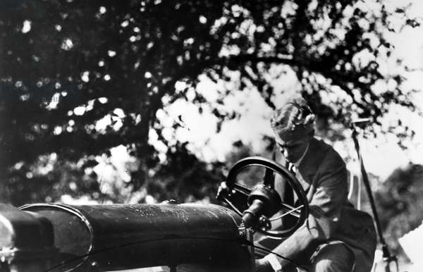 HENRY FORD (1863-1947) American automobile manufacturer. Ford photographed with one of his automobiles, early 20th century.
