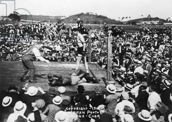 JESS WILLARD (1883-1968) knocking out Jack Johnson in the 26th round of their Heavyweight Championship bout in Havana, Cuba, on April 5, 1915.