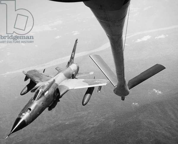 VIETNAM WAR: F-105, 1967 A U.S. Air Force F-105 Thunderchief supersonic fighter-bomber in flight over Vietnam, 1967.