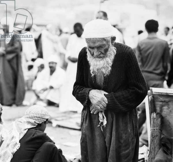 PILGRIM TO MECCA, 1970s An old man at prayer during his pilgrimage to Mecca, Saudi Arabia. Photograph, 1970s.