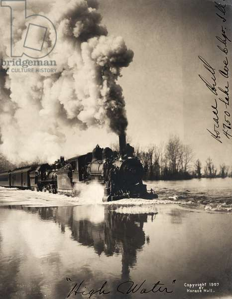 ILLINOIS: FLOOD, c.1907 Flooding along the railroad tracks in Illinois. Photograph, c.1907.