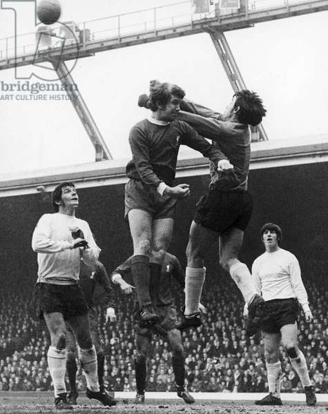 ENGLAND: SOCCER GAME, 1970. Gordan Banks, the goalkeeper for Stoke City FC punches the ball away from Chris Lawler of Liverpool during a game, 26 December 1970.