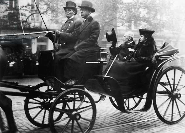 WOODROW WILSON (1856-1924) 28th President of the United States. Riding in a surrey, probably in Washington, D.C., with the First Lady, Edith Bolling Galt Wilson, 1921.