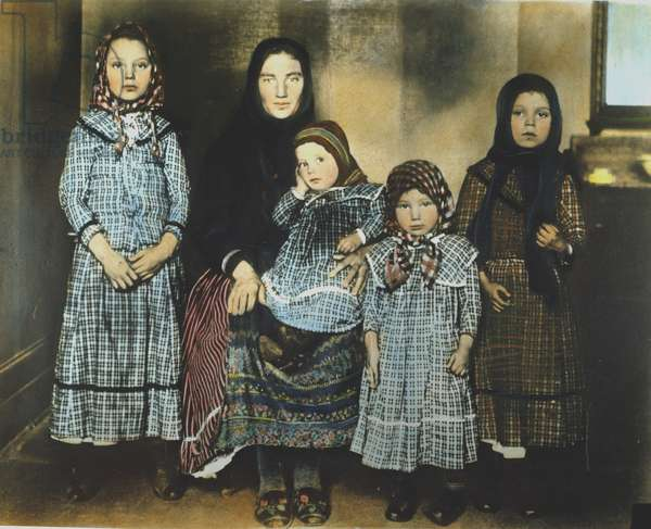 IMMIGRANT MOTHER, c.1900 A mother and her children at Ellis Island. Oil over a photograph.