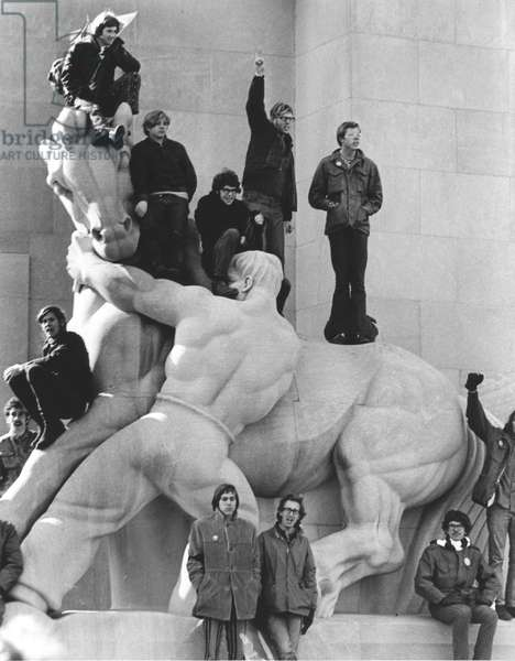 ANTI-WAR PROTEST, 1969 Demonstrators climb a statue on Pennsylvania Avenue in protest the war in Vietnam during the 15 November 1969 march on Washington, D.C.