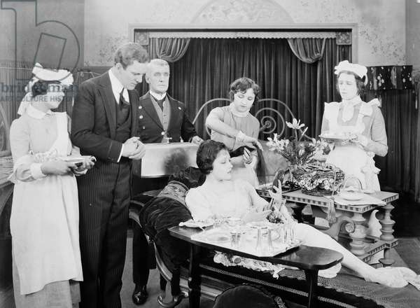 MALE & FEMALE, 1919 Gloria Swanson (seated) in a scene from the film directed by Cecil DeMille.