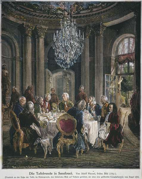 FREDERICK II OF PRUSSIA (1712-1786) with Voltaire at the round table at Sans Souci palace. Wood engraving after Adolph von Menzel.