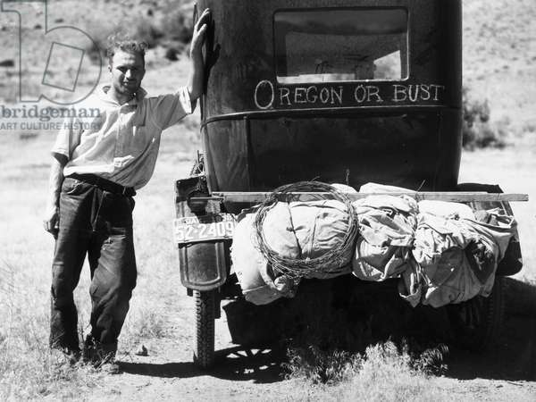 MONTANA: DROUGHT, 1936 Man fleeing drought and grasshoppers in South Carolina, with his Model T Ford on Highway 10, Missoula, Montana. Photograph by Arthur Rothstein, 1936.