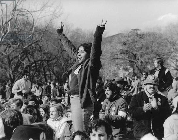 HIPPIE MOVEMENT, 1969 A woman standing in a crowd of hippies at the 1969 anti-Vietnam War march on Washington, D.C.