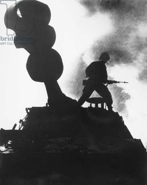 VIETNAM WAR: HOWITZER A paratrooper of the 173rd Airborne Brigade stands guard atop a 155mm self-propelled howitzer in War Zone D, South Vietnam, late 1966.