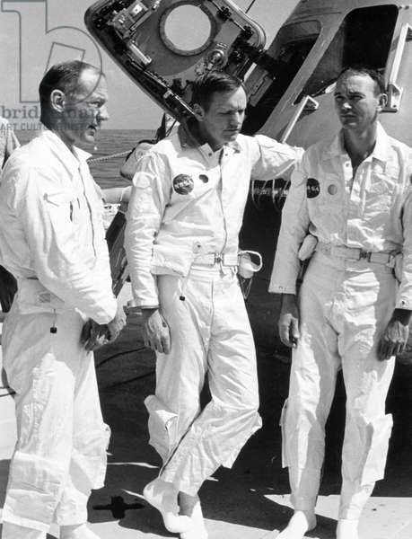SPACE: APOLLO 11 CREW From left to right, astronauts Edwin E. Aldrin, Neil A. Armstrong and Michael Collins aboard the NASA motor vessel retriever prior to participation in water egress training, 24 May 1969.