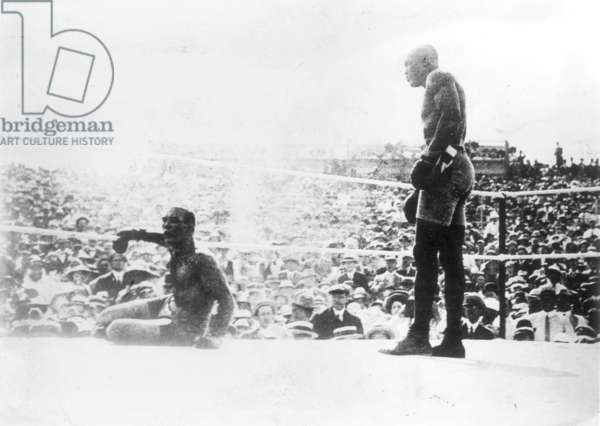 JACK JOHNSON (1878-1946) American heavyweight pugilist. Jack Johnson knocking out James J. Jeffries in the 15th round in Reno, Nevada, 4 July 1910.