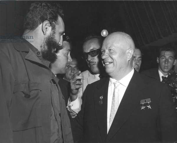 CASTRO & KHRUSHCHEV. Premier Fidel Castro of Cuba and Soviet Premier Nikita Khrushchev greeting each other in the General Assembly of the United Nations, New York, Sept. 20, 1960.