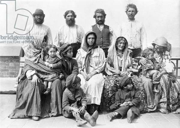 ELLIS ISLAND: IMMIGRANTS Group of gypsy immigrants photographed after their arrival at Ellis Island, late 19th or early 20th century.