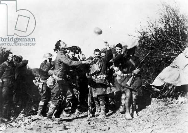 WORLD WAR I: ARMISTICE American soldiers of Company M, 6th Infantry Regiment, celebrating the World War I armistice at Remoiville, France, 11 November 1918.