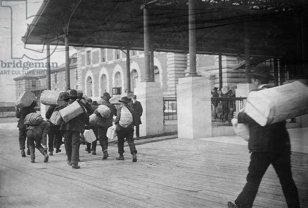 IMMIGRANTS: ELLIS ISLAND A group of European immigrants photographed at Ellis Island, c.1907.