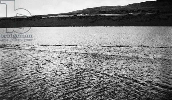 LOCH NESS MONSTER, 1934 Photograph showing the wake of the monster travelling just below the surface of the water. Photograph from a 1934 English newspaper.