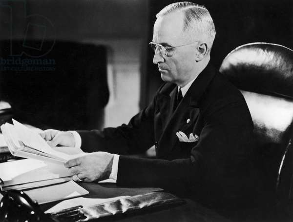 HARRY S. TRUMAN (1884-1972) 33rd President of the United States. Photographed at his White House desk in 1945.