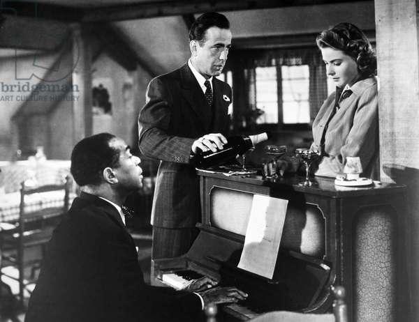 CASABLANCA, 1942 Dooley Wilson, Humphrey Bogart, and Ingrid Bergman in a scene from 'Casablanca,' 1942.