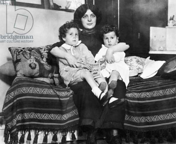 TITANIC: SURVIVORS, 1912 Young survivors of the 'Titanic' Louis (left) and Michel Navratil on their mother's lap after being reuinted. Photographed 1912.