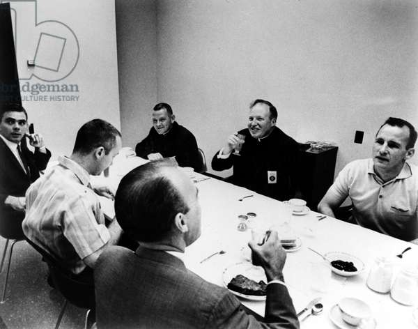 GEMINI IV ASTRONAUTS, 1965 Astronauts of the Gemini IV mission at breakfast with two priests and two doctors before the launch of the spacecraft, 3 June 1965. Shown clockwise from front center: Dr. D.O. Coons, Command pilot James McDivitt, Dr. Eugene Tubbs, Reverend James Heiliky, Messenger Irvine Nugent, and pilot Edward White.