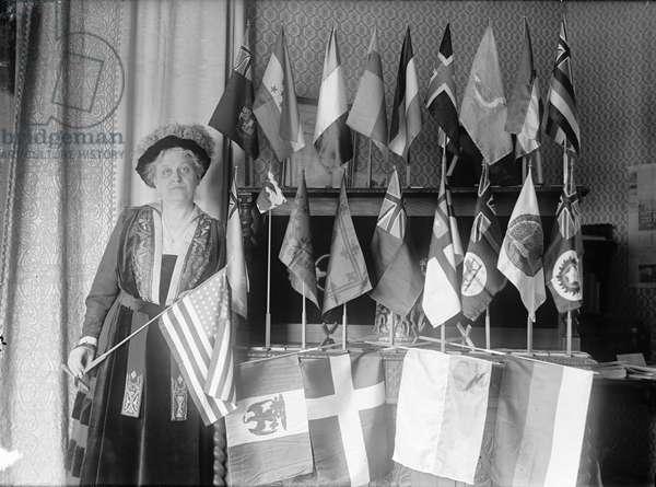 CARRIE CHAPMAN CATT (1859-1947). Carrie Clinton Chapman Catt. American reformer and women's rights advocate. Photographed with the flags of 22 nations, 1917.