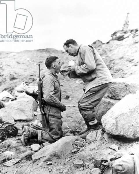 WORLD WAR II: IWO JIMA An United States Marine receiving Communion on Iwo Jima, 1945.