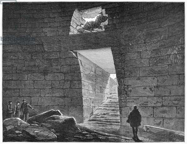 MYCENAE: TREASURY, 1877 Interior of the Treasury of Atreus, a tholos tomb in Mycenae, Greece, constructed c.1250 B.C. and excavated by Dr. Heinrich Schliemann. English engraving, 1877.