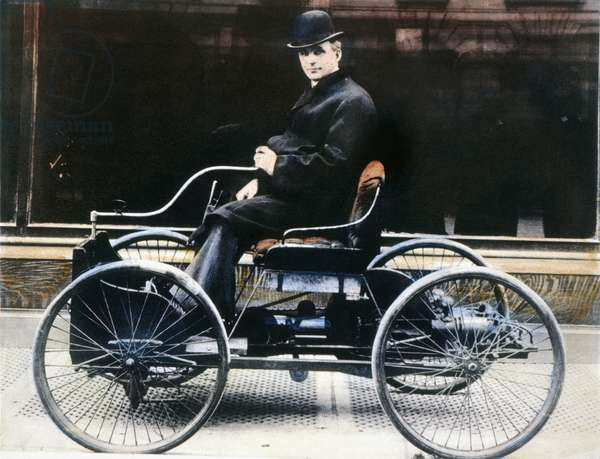 HENRY FORD (1863-1947) American automobile manufacturer. Ford in 1896 with the first Ford automobile. Oil over a photograph.