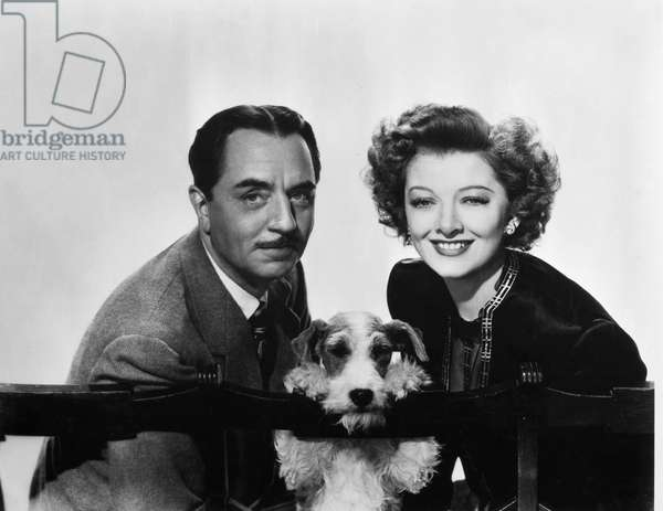 THIN MAN, 1934 William Powell and Myrna Loy as Nick and Nora Charles with their dog Asta in the 1934 motion picture, 'The Thin Man.'