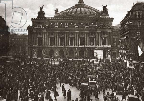 WORLD WAR I: CELEBRATION Crowd at The Place De L'Opera celebrating the signing of the Armistice in Paris, France. Photograph, November 11, 1918.