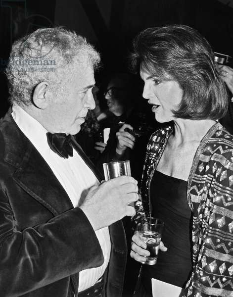 JACQUELINE KENNEDY ONASSIS (1929-1994). Wife of Aristotle Onassis and President John Fitzgerald Kennedy. Onassis with Norman Mailer at a publishing party in New York. Photographed 1978.