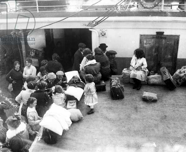 IMMIGRANT SHIP, 1919 Italian immigrants on board a ship arriving at Ellis Island, New York City. Photograph, 1919.