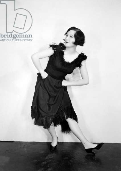 JOAN CRAWFORD (1908-1973) American actress. Crawford doing the Black Bottom dance in a publicity still from the 1920s.