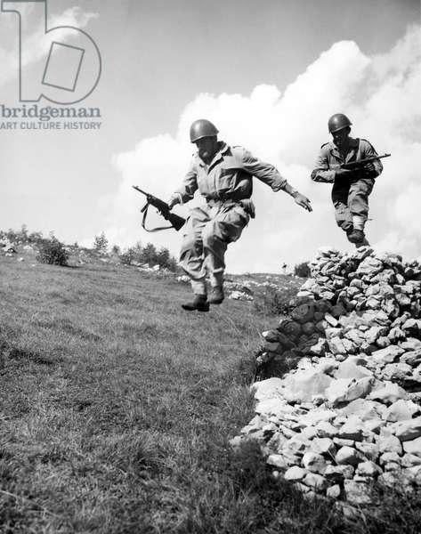 ITALIAN WAR EXERCISES, 1952 Italian infantrymen rush toward the 'enemy' during the NATO fall maneuvers at Udine, Italy, 1952.