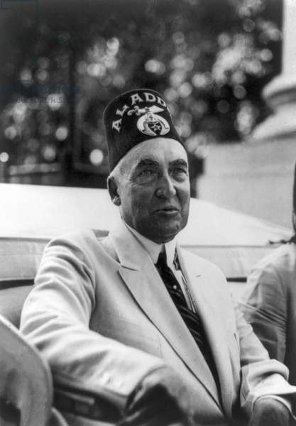 WARREN G. HARDING (1865-1923). 29th President of the United States. Photographed wearing a Freemason hat, c.1921-23.