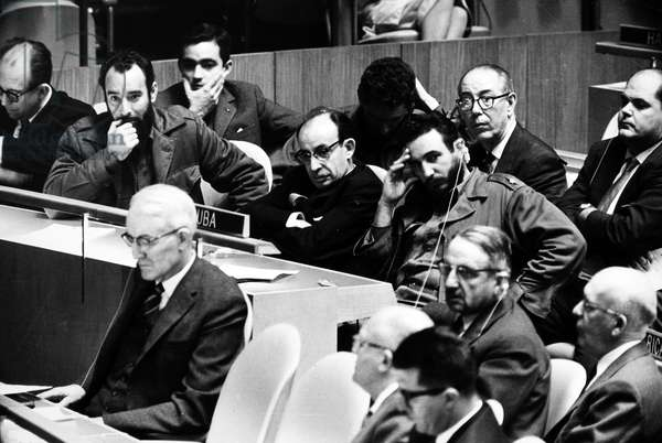 FIDEL CASTRO (1926- ) Cuban political leader. Premier Castro (at right, with earphones) at the opening of the 15th regular session of the United Nations General Assembly, September 1960.