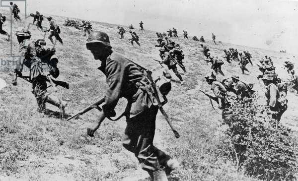 WWII: STALINGRAD ATTACK German troops charging up a hill near Stalingrad, October 1942.