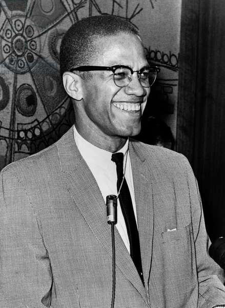 MALCOLM X (1925-1965) Born Malcolm Little. American religious and political leader. Photograph by Ed Ford, 1964.