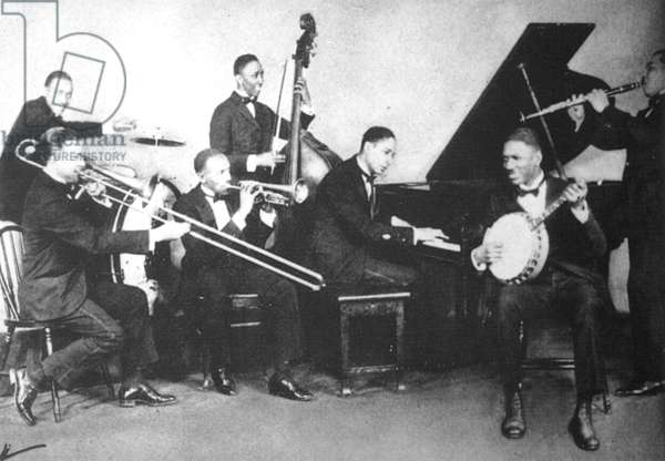 JELLY ROLL' MORTON (1885-1941). Ferdinand Joseph La Menthe. American musician. Jelly Roll Morton (at piano) with his group, The Red Hot Peppers, 1926.