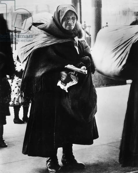 IMMIGRANTS: ELLIS ISLAND An immigrant woman at Ellis Island, c.1900.
