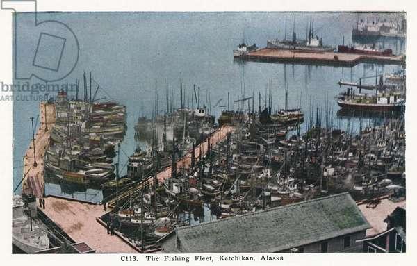 ALASKA: KETCHIKAN, c.1930 A fleet of fishing boats at Ketchikan, Alaska. Postcard, American, c.1930.