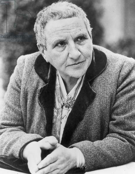 GERTRUDE STEIN (1874-1946) American writer. Photographed in 1942.