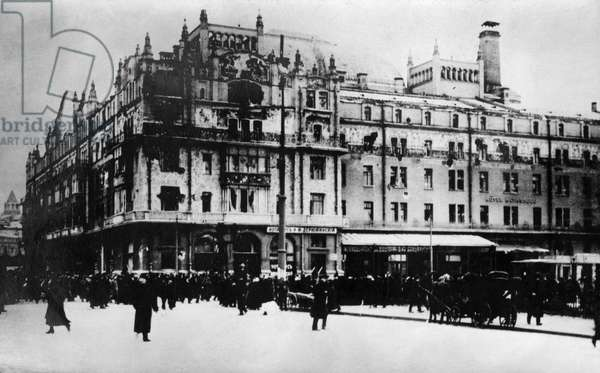 MOSCOW, c.1917 People gathered outside of buildings damaged by fighting during the Russian Revolution in Moscow, Russia. Photograph by James Maxwell Pringle, 1917 or 1918.