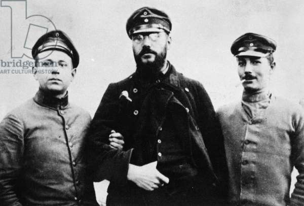 KURT TUCHOLSKY (1890-1935) German writer and critic. Tucholsky, at left, as a solider in World War I, with two companions. Photograph, c.1918.