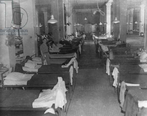 ELLIS ISLAND: DORMITORY Sleeping quarters for 'alien enemy' seamen detained at Ellis Island, during World War II. Photograph, c.1943.