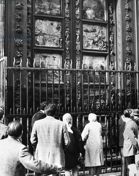 FLORENCE: FLOOD, 1966 The bronze doors of the Baptistry of San Giovanni in Florence, damaged by the flood of the Arno River. Photograph, 8 November 1966.