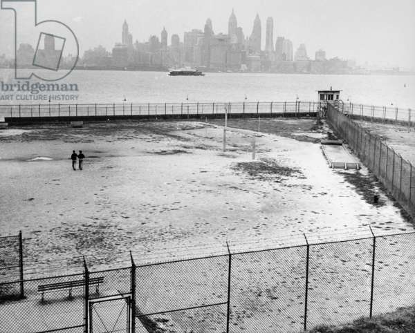 ELLIS ISLAND, 1954 Deserted athletic fields at Ellis Island, shortly before its closure. Photograph, 1954.